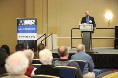 Dr. David Makin, ACJS program chair, introducing the ACJS President Dr. Faith Lutze. Photo credit to ACJS.