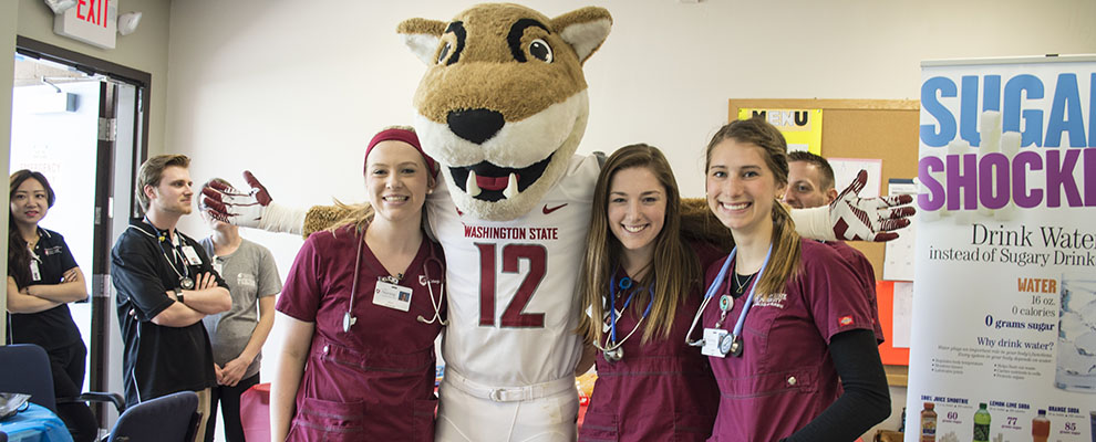 nursing students and Butch T. Cougar at community health fair in 2016