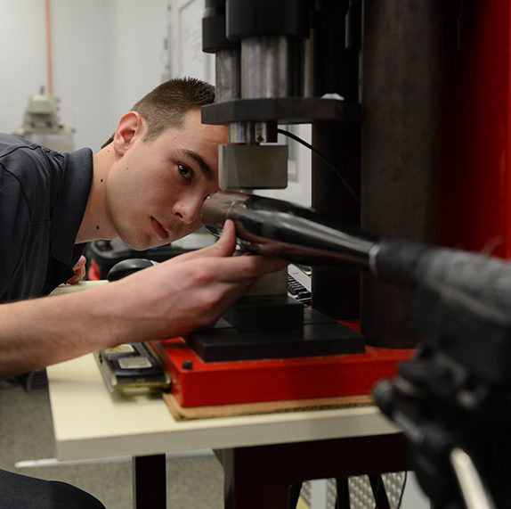 Student testing a bat in the Washington State University Sports Science Lab.