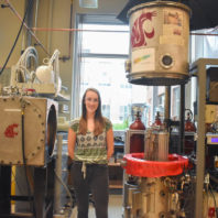 Jordan Raymond, Donna Jung Scholarship Award winner, posing in a lab at WSU.