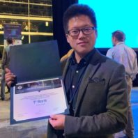 Yu-Chung Chang posing with his award.