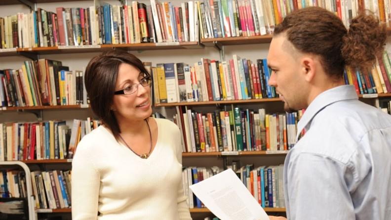 Dr. Carmen Lugo-Lugo with student