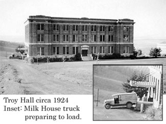 Troy Hall on the Pullman Campus, circa 1924. Inset with a Milk House truck preparing to load.