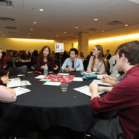 Maureen Schmitter-Edgecombe speaking with the students at her table.