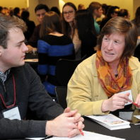 Shelley Pressley talks to a student at the freshman scholars progression 2018 event