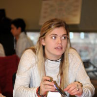 A student asking a question at the Freshman Scholars Progression 2018 event