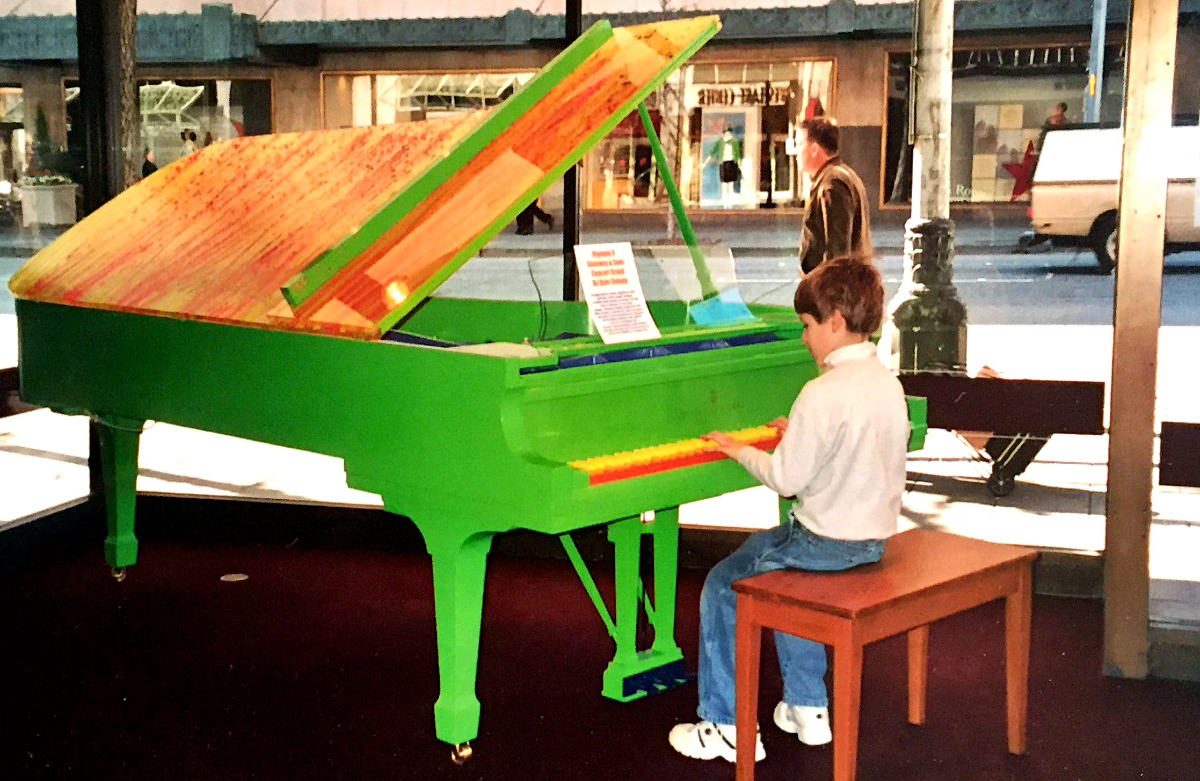 Fulbright 2019 recipient Garrett Snedeker playing piano at a young age.