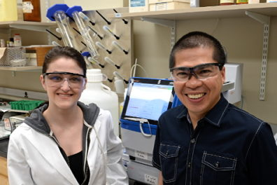 A student standing with her research mentor in the lab.