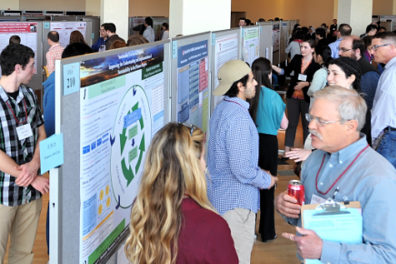 Undergraduate researchers presenting their work at SURCA