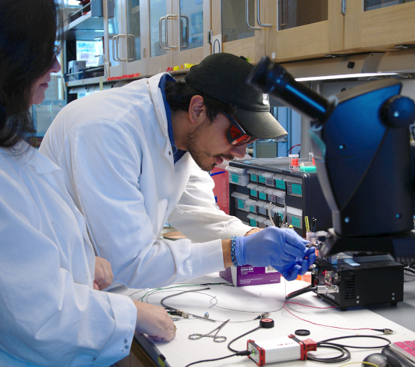 Christian Ibarra prepares a sample to be imaged while working in the lab.