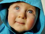 Baby in a blue hoodie