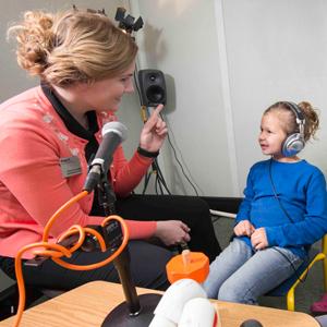 Speech student with child