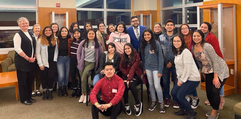 Luis Cortes Romero posing for a group photo with WSU students who attended his presentation.