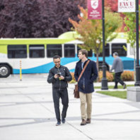 Two students arriving to campus on the bus