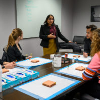 Radha Nandagopal, a new member of the President's Teaching Academy, speaks to students around a table.
