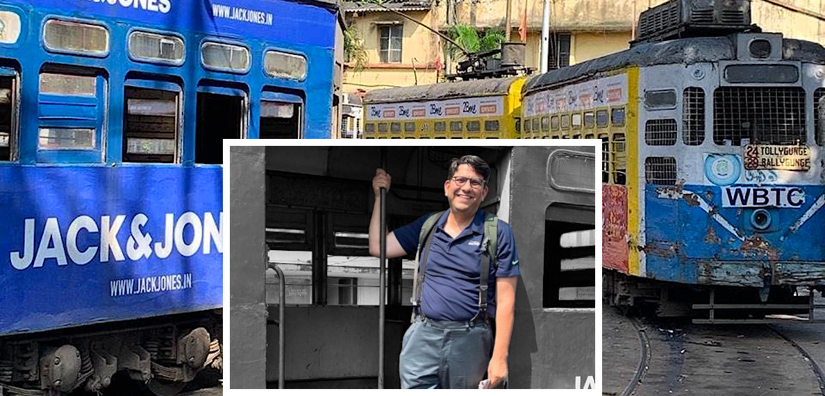 History doctoral student Ryan Booth poses at a train station in an Indian city. Booth is in India on a Fulbright studying sociocultural issues.
