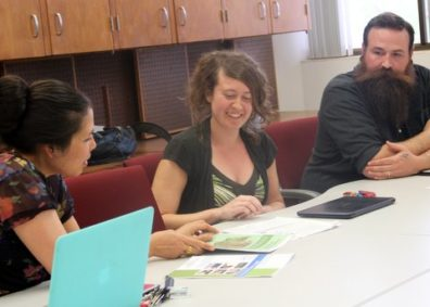 SESRC Director Lena Le (left) chats with survey clinic consultants Sarah Morton and James McCall.