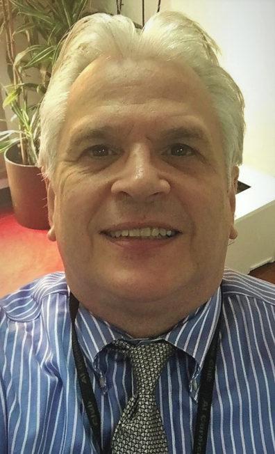 Photo of Donald Beck, PhD 1991, smiling at the camera.