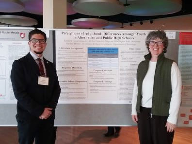 Undergraduate sociology major, Leo Covarrubias with department chair, Monica Johnson, standing next to Leo's poster, presented at the Showcase for Undergraduate Research and Creative Activities (SURCA).
