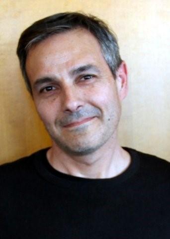A photo of Tom Rotolo, faculty co-editor.