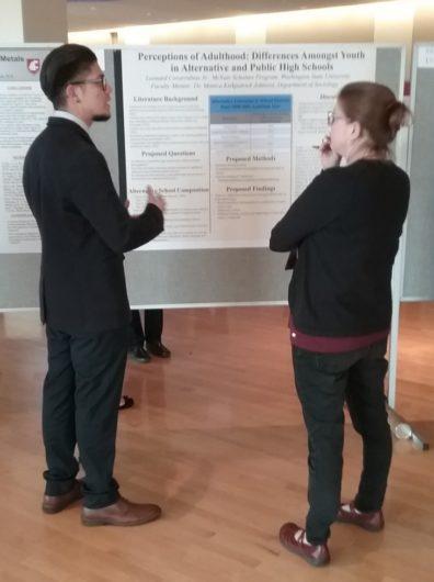 Undergraduate major, Leo Covarrubias conversing with a SURCA judge about his research.