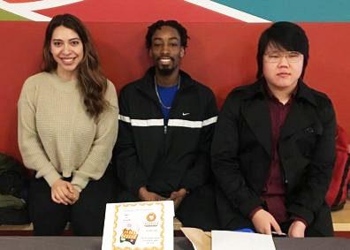 Undergraduate Sociology Club members, Briseida Soberanes, Jorden Calloway, and Julius Kim, fundraising on campus.