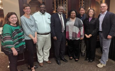 Several WSU faculty and staff members stand with Robert Bullard for a photo.