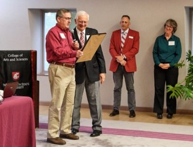 WSU President Kirk Schulz handing a certificate of thanks to Don Dillman for his first 50 years of service. Matthew Jockers and Monica Johnson stand in the background.
