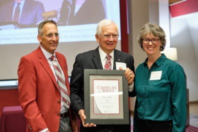 Matthew Jockers, Don Dillman, and Monica Johnson standing together while Don holds the certificate, for 50 years of service at WSU, that he was just awarded.