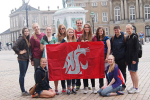 students with professor Anderson holding Cougar flag
