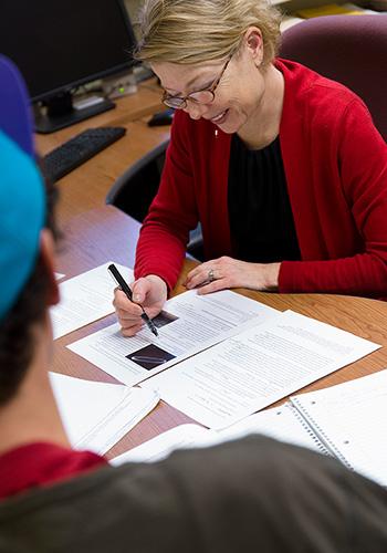 Assistant Dean Robin Bond advising a student