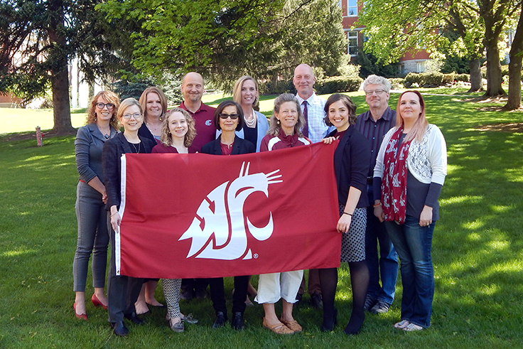 Faculty and Staff of the Honors College holding a WSU Cougar Flag