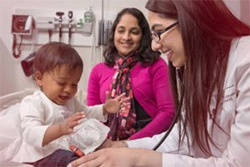 College of Medicine student working with a child