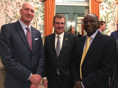 Dean Norton with the Chargé d'Affaires Matthew Lussenhop (center)