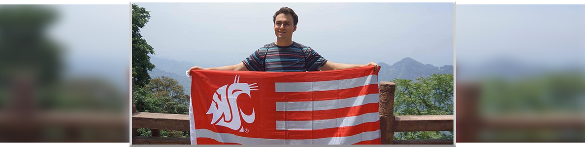 Ryan Fick holding cougar flag