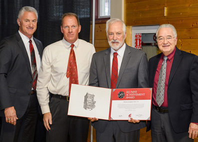 Thomas Lupkin pictured receiving the Alumni Achievement Award