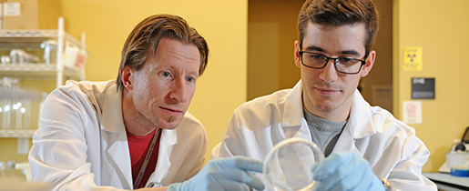 Zachary Howard with Anders Omslan in the lab