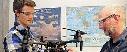 Gubsch and Von Walden shown making adjustments to a drone
