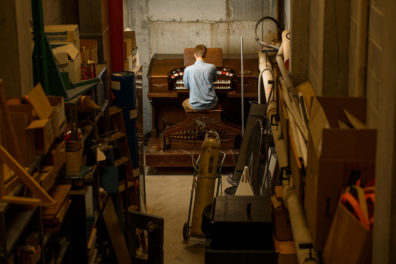 Thomas LeClair  sitting at the pipe organ