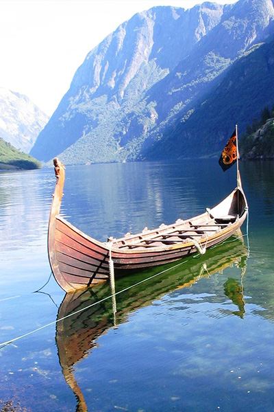 Traditional Viking boat on an alpine lake