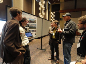 Participants discuss research at last year's annual JCATI symposium.