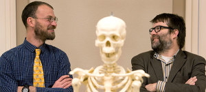 WSU historian Jesse Spohnholz, left, and molecular anthropologist Brian Kemp. Skeleton in foreground is not that of King Richard III. (Photo by Shelly Hanks, WSU Photo Services)