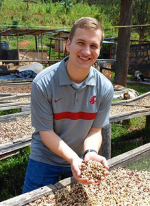 WSU-student-team-member-with-coffee-beans-in-Rwanda