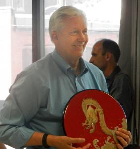 Glenn Johnson, WSU communication professor and Pullman mayor, with a gift from Japan.