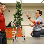 Changki Mo, right, talks with doctoral student Joseph Davidson about the physical design of an apple-picking robot. (Photo by Maegan Murray, WSU Tri-Cities)