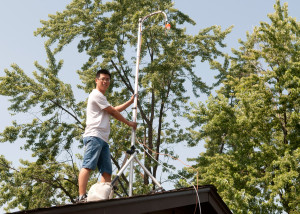Graduate-student-Yibo-Huangfu-on-house-room-with-air-quality-instruments-web