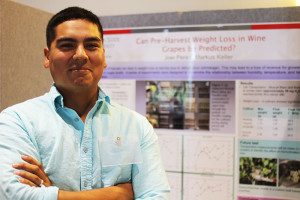 Joel Perez, a master's student in Viticulture and Enology, entered his poster on water loss from grapes.