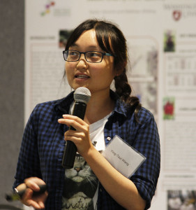 Doctoral student Ying-Tsai Wang shares her model of apple tree growth at the expo.