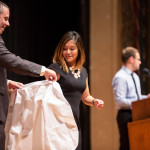 Walgreen's representative and WSU pharmacy alumnus Nick Bruck presented white coats to the new students. (Photos by Jacque Garza, WSU student pharmacist class of 2016)