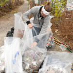 Club officer Randy Bartoshevich organizes trash during the Bateman Island cleanup. (Photos by Justin Hawkes)
